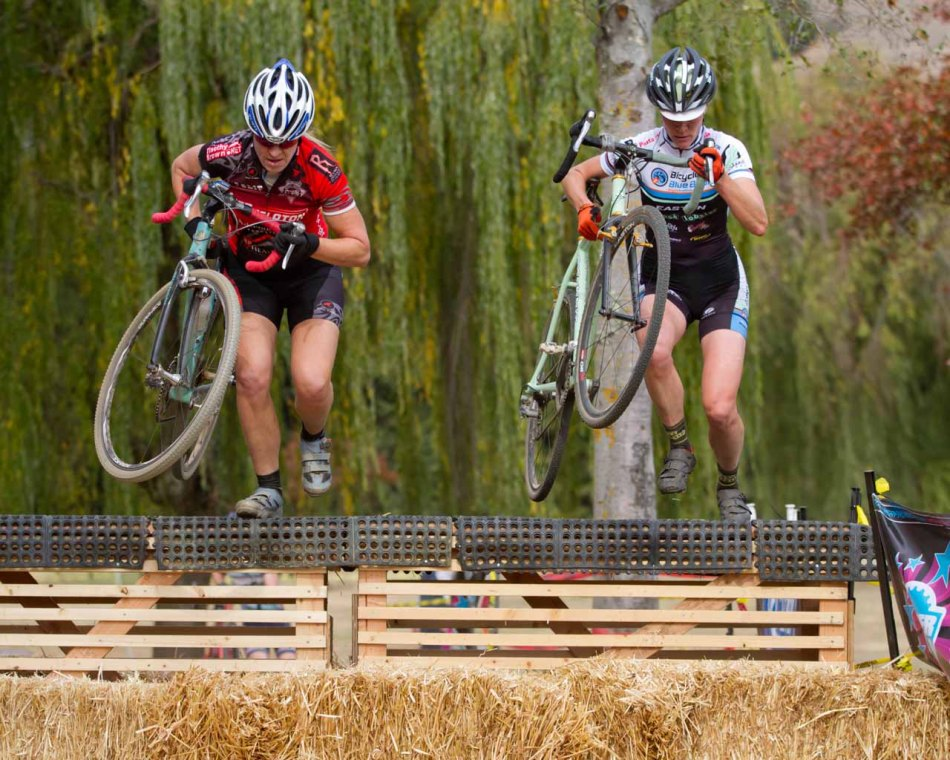 Kristin Drumm and Katie Jay Melena going over the Belgium Wall at Stafford Lake