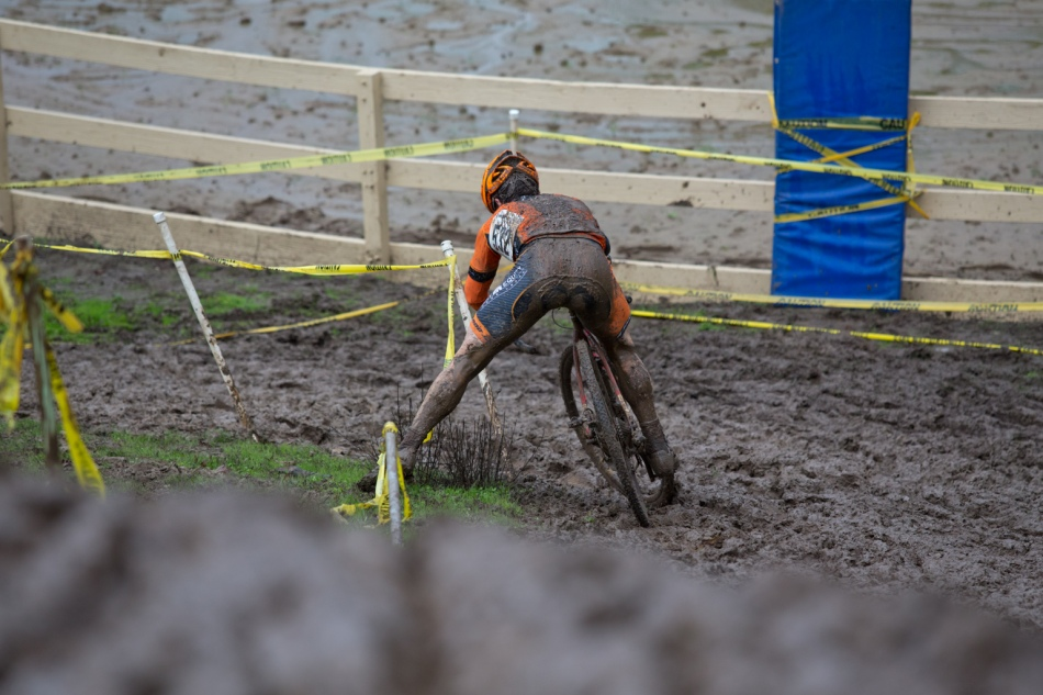 Ryan Greuier Tripods Around the Posts at the Bottom of a Muddy Hill