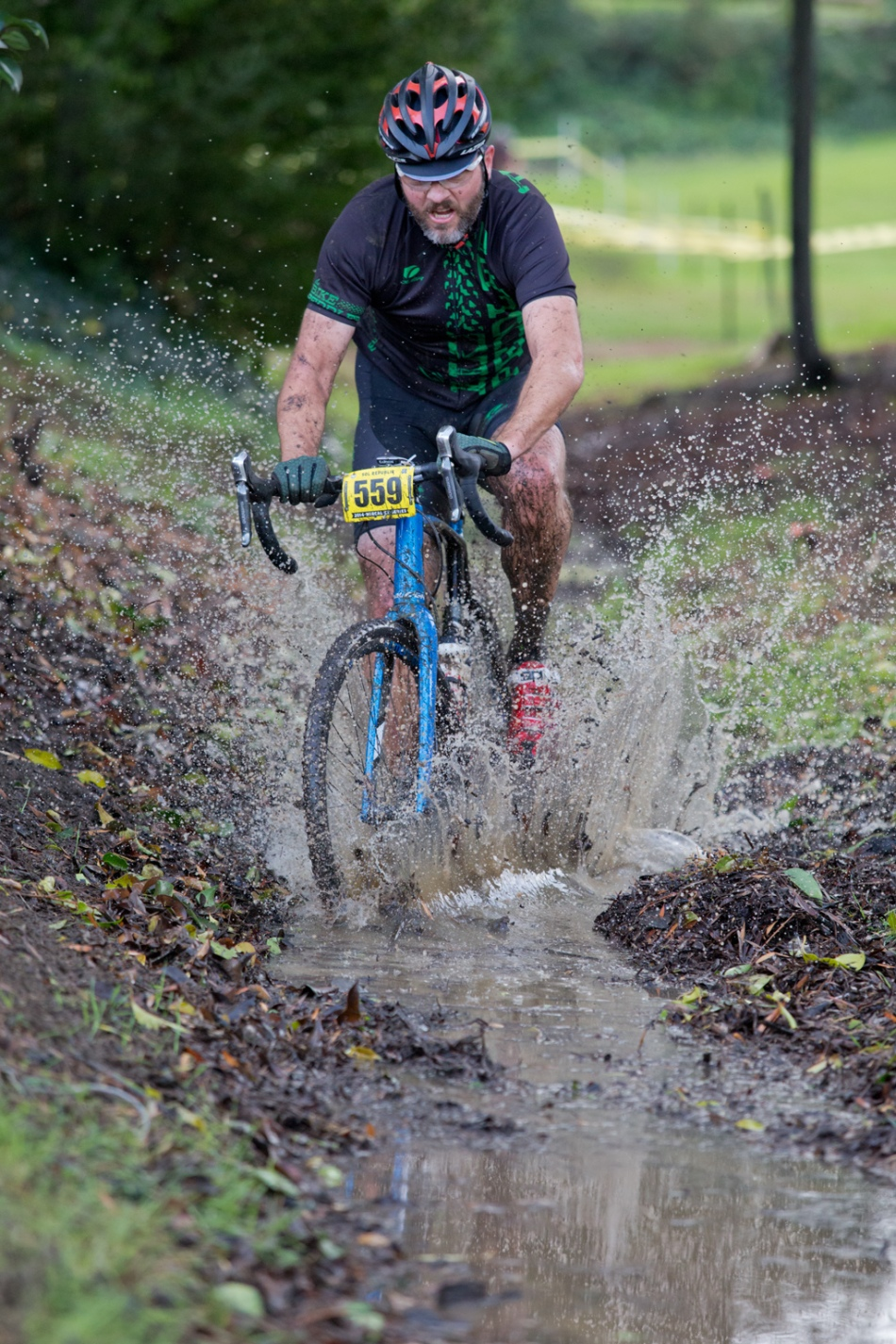 Murphy Mack takes the Kitten of Vallejo course along a creek for Ryan Harding to experience