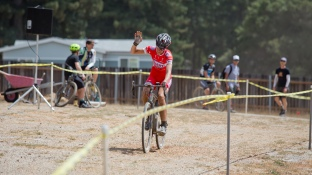 Rachel Lloyd Raises a Weary Arm after a Hard-Fought Victory